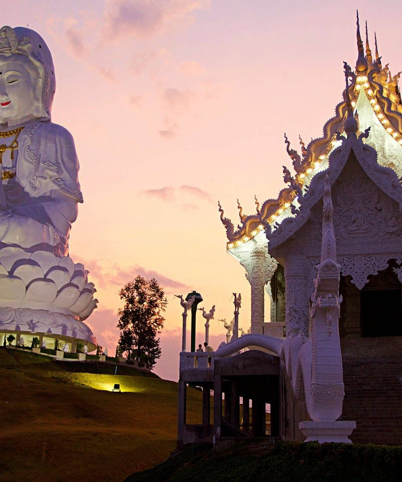 The giant Buddha statue next to 9 tier temple, Chiang Rai