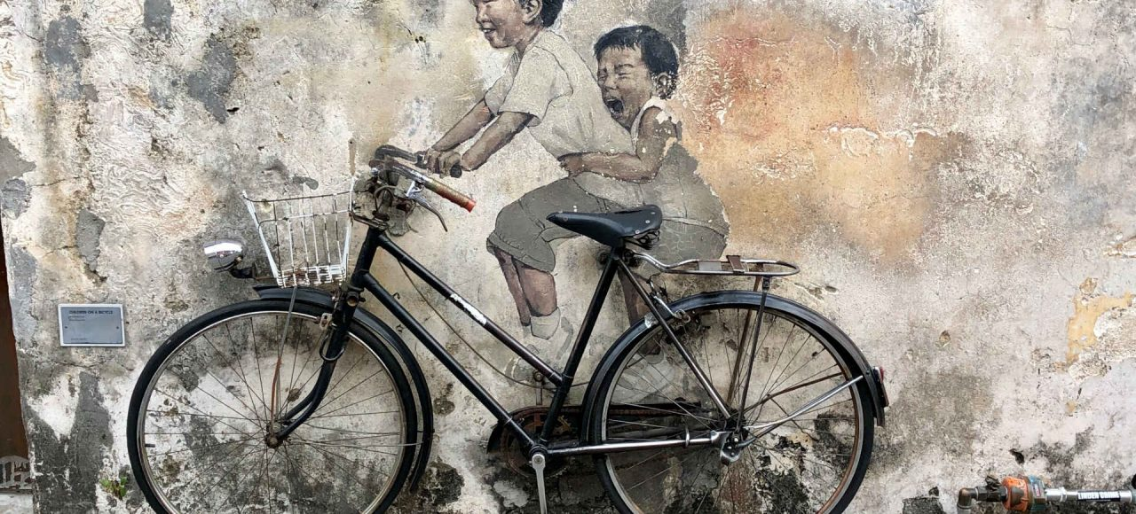 Little children on a bicycle, street art Penang